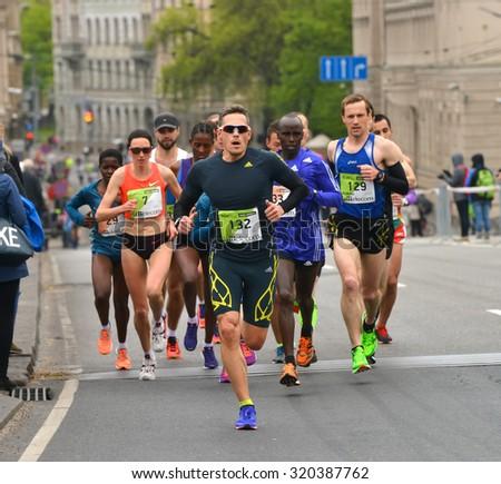 Riga, Latvia - May 17, 2015: Lattelecom Riga Marathon with 25 931 participants from 69 countries. Marathon and half marathon distance. - stock photo