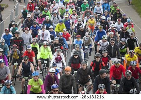 RIGA, LATVIA - MAY 31, 2015: Mass start of Riga Cycling Marathon Folk Distance (31.6km). - stock photo