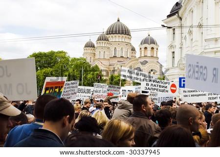 RIGA, LATVIA, MAY 16, 2009: Protesters against Baltic Gay Pride 2009 in Riga, Latvia, May 16, 2009. - stock photo
