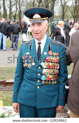 RIGA,LATVIA - MAY 9: Veteran of World war II on the parade May 9, 2010 in Riga,Latvia. - stock photo