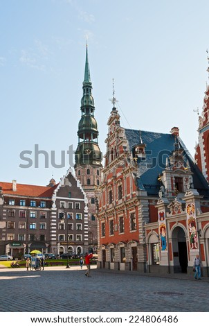 RIGA, LATVIA. SEPTEMBER 01, 2014 - City Hall square, Blackheads House and the Cathedral of St. Peter in the center of Riga - stock photo