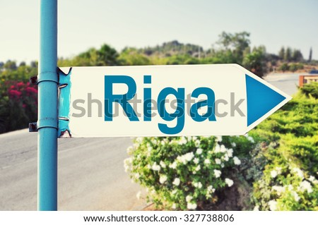 Riga Road Sign with beautiful nature and road on background - stock photo