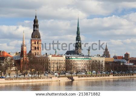 Riga Skyline.  A view across the River Daugava to the skyline of Riga, capital of Latvia.  - stock photo