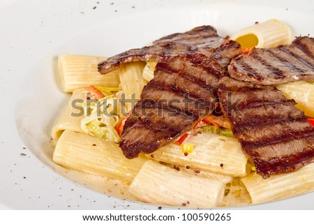 Rigatoni pasta with a beef and sauce
