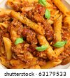 Rigatoni pasta with beef and tomato ragu. - stock photo