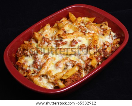 Rigatoni pasta with bolognese sauce and cheese. - stock photo