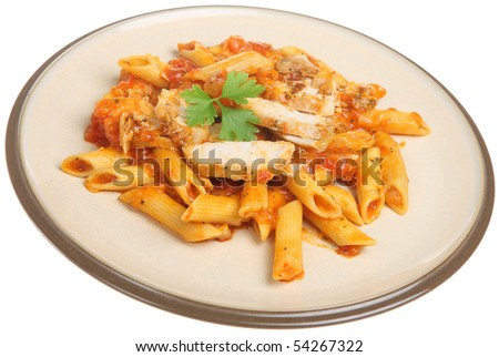 Rigatoni pasta with chicken and tomato sauce. - stock photo