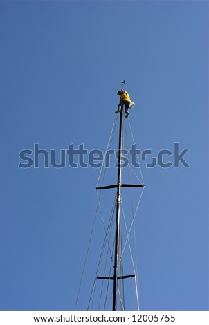 Rigging a sailing yacht – Man High Up in the Mast - stock photo