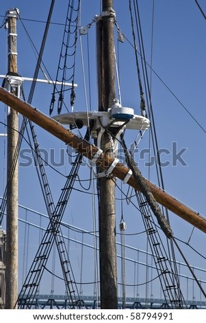 Rigging on a wooden sailboat docked in Philadelphia Pennsylvania along the Delaware River. - stock photo