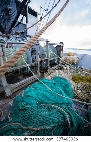 Rigging on the deck of small fishing vessel. Evening time, sea of Japan.
