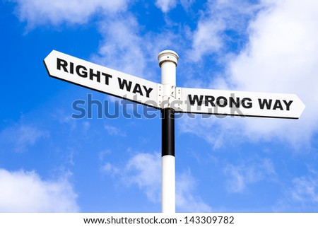 Right and wrong directional signpost - stock photo