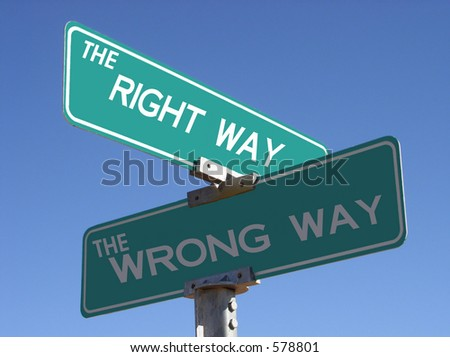 right and wrong way street sign - stock photo