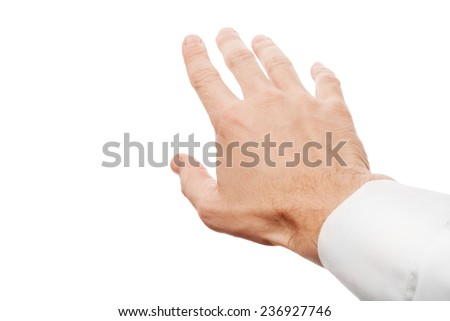 Right business man hand trying to grab something, first-person view photo with selective focus isolated on white background - stock photo