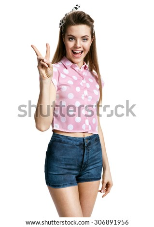 Right hand gesture peace sign / photo of young cheerful brunette woman over white background, positive emotions - stock photo
