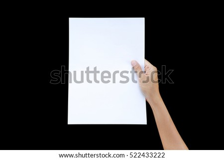 Right hand holding sheet of paper isolated on black background.