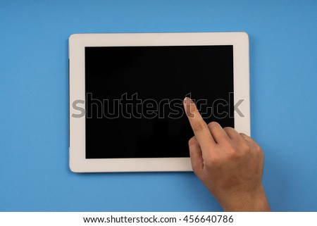 right hand touch tablet, blue color background - stock photo