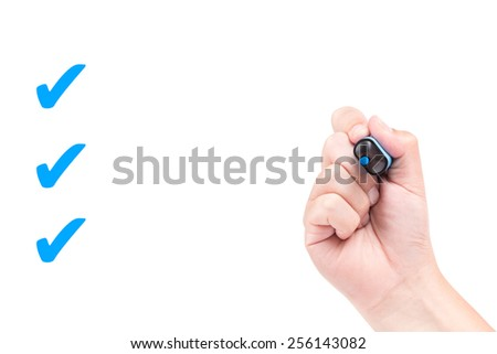 Right hand with blue marker draw a check mark isolated on white background - stock photo