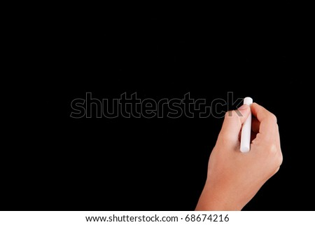 Right Hand writing on a blackboard in white - stock photo