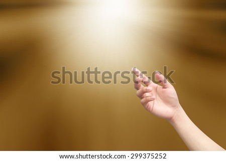 right hands praying on blurred sepia tone background : hand open receiving power from god. religion concept. - stock photo