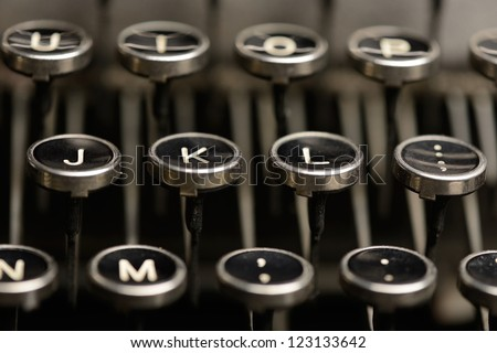 Right home row keys on an antique typewriter. Close-up of the right half of home row keys on an old typewriter. - stock photo