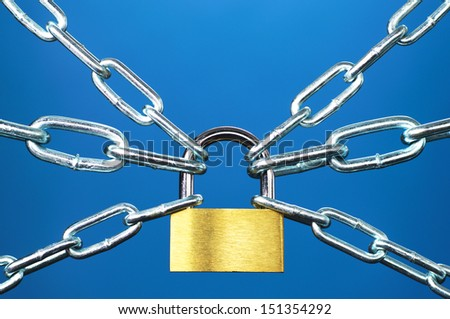 Rigid control. Padlock and chain on blue background.  - stock photo