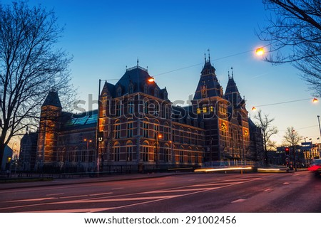 Rijksmuseum in Amsterdam, Netherlands. Night view of Dutch national museum, which has on display thousands objects of art and history and very popular among tourists - stock photo