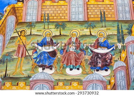 Rila, Bulgaria - June, 25, 2015: Wall painting  of Abraham, Isaac, Jacob at Rila Monastery church. The monastery is the largest in Bulgaria and a UNESCO World Heritage site - stock photo