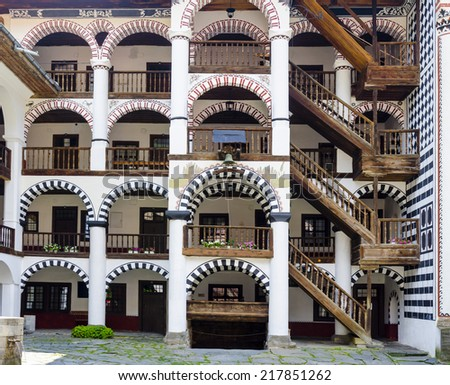 Rila, Bulgaria - portica with timber stairway to rooms in the Unesco World Heritage site Monastery of Saint Ivan of Rila - named Rila monastery - stock photo