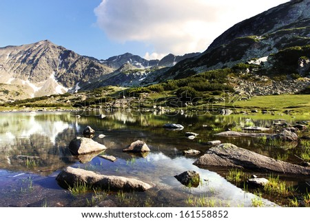 Rila Mountains in Bulgaria with clear lagoon in the front - stock photo