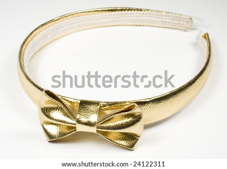 Rim for hair with golden knot-butterfly on a white background - stock photo