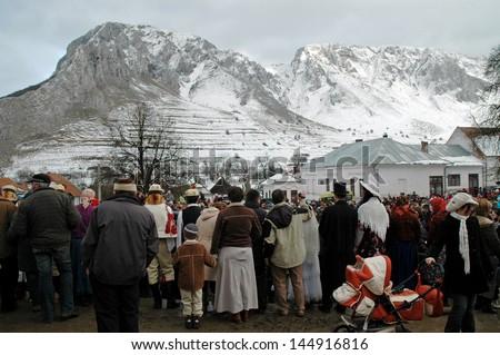 RIMETEA - FEB 28: Local unidentified villagers of Rimetea (Torocko) attending a unique show, the celebration and carnival with mask at the ending of winter. On February 28, 2009, in Rimetea, Romania. - stock photo