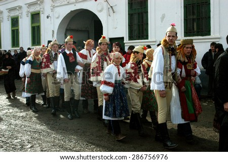 RIMETEA - FEB 28: Local unidentified villagers of Torocko attending the carnival show, the celebration at the ending of winter on February 28, 2004 in Rimetea, Romania                                  - stock photo