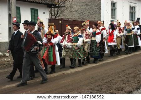 RIMETEA - FEB 28: Unidentified villagers of Rimetea attending a unique show, the celebration and carnival at the ending of winter. On Feb 28, 2009 in Rimetea, Romania.                                  - stock photo