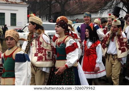 RIMETEA - FEBRUARY 28: Unidentified people of Torocko village attending the carnival show, the celebration at the ending of winter on February 28, 2004 in Rimetea, Romania        - stock photo