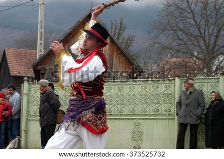 RIMETEA, ROMANIA - FEBRUARY 28: Unidentified people of Torocko village attending the carnival show, the celebration at the end of winter on February 28, 2004 in Rimetea, Romania      - stock photo