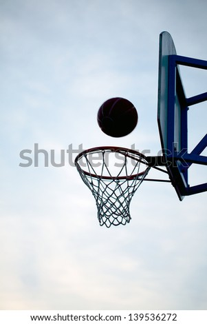 ring and ball on background of the sky and the city - stock photo