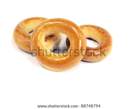 Ring bagels on a white background - stock photo