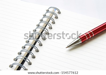 ring binder book or notebook with pen  isolated on white - stock photo