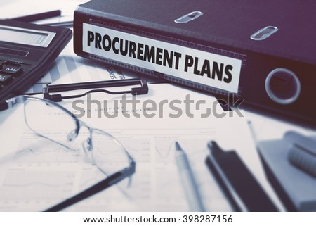 Ring Binder with inscription Procurement Plans on Background of Working Table with Office Supplies, Glasses, Reports. Toned Illustration. Business Concept on Blurred Background. - stock photo