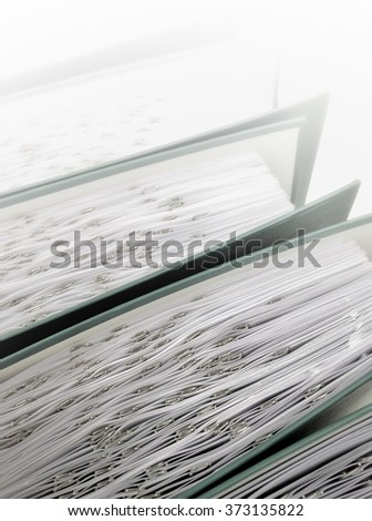 Ring binders in a row fading to white - stock photo