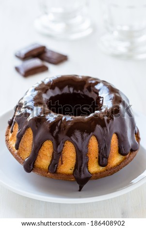 Ring cake with chocolate on the top - stock photo
