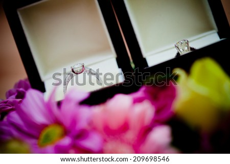 Ring newlyweds Flower ring box near the top - stock photo