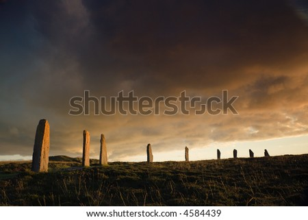 Ring of Brodgar in dramatic evening light and cloudscape - stock photo
