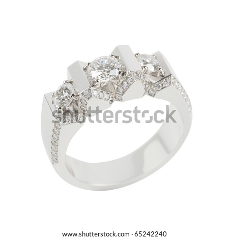Ring of gold and white gold on white - stock photo