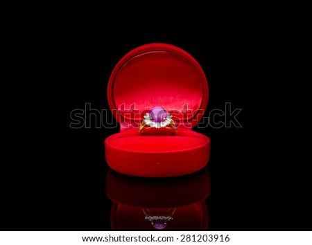 Ring of the jewelry in a gift box on black background - stock photo