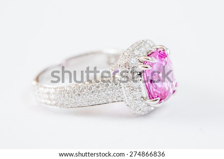 Ring of the jewelry with pink sapphire isolated on white background - stock photo