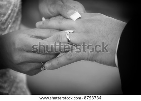 Placing Wedding Ring On Black Finger