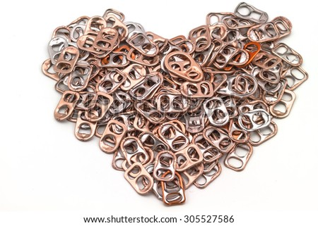 Ring pull aluminum of cans stack as heart shape indicate of new hope on white background processed in tinted photo in red tone - stock photo