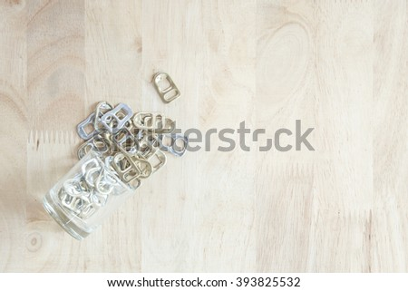 ring pull on a wooden surface - stock photo