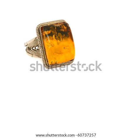 Ring with amber on a white background - stock photo